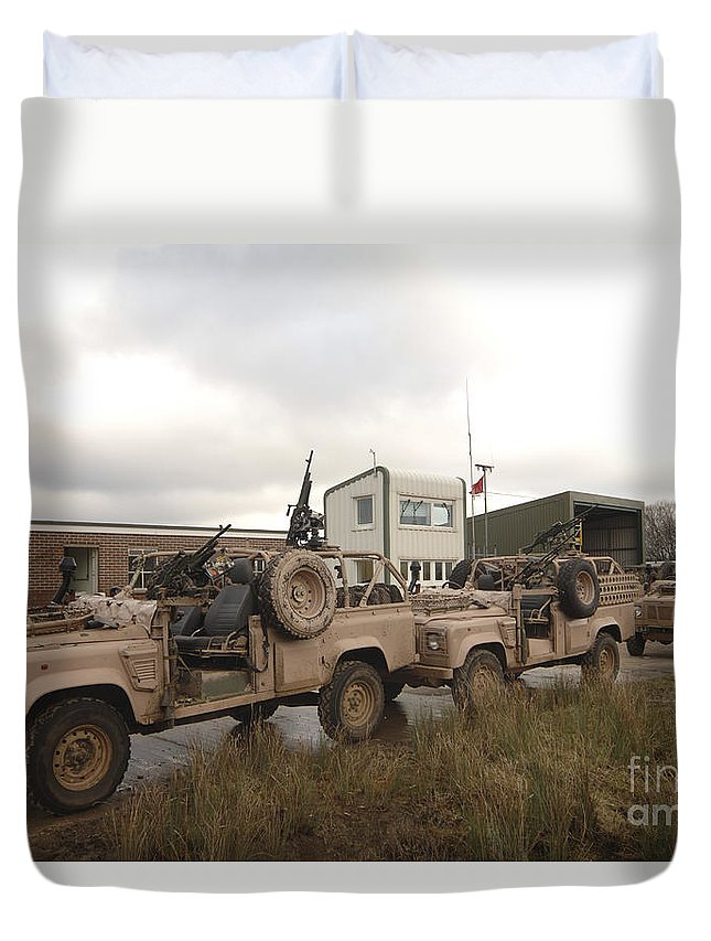 Foreign Military Duvet Cover featuring the photograph A Pink Panther Land Rover by Andrew Chittock