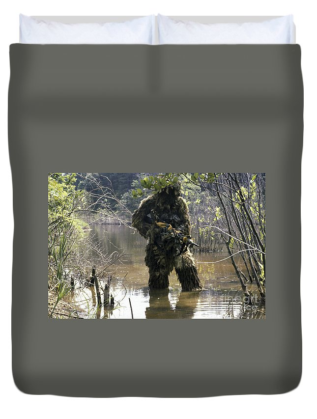 Three Quarter Length Duvet Cover featuring the photograph A Sniper Dressed In A Ghillie Suit by Stocktrek Images