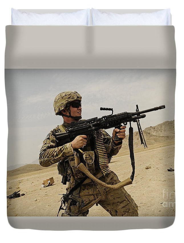 Army Duvet Cover featuring the photograph A Soldier Firing His Mk-48 Machine Gun by Stocktrek Images