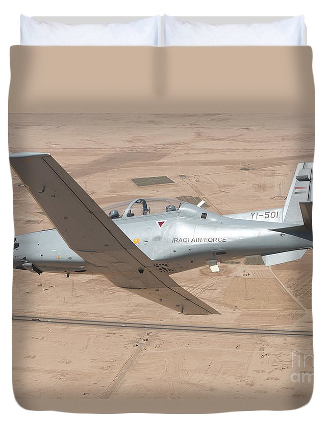 Trainer Duvet Cover featuring the photograph A T-6 Texan Flying Over Camp Speicher by Stocktrek Images