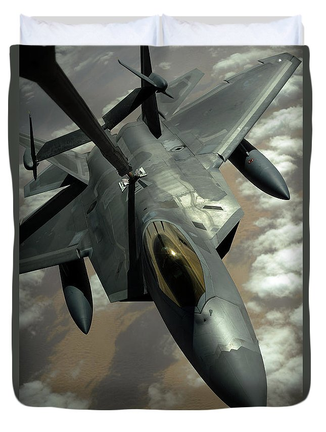 Warplane Duvet Cover featuring the photograph A U.s. Air Force F-22 Raptor by Stocktrek Images