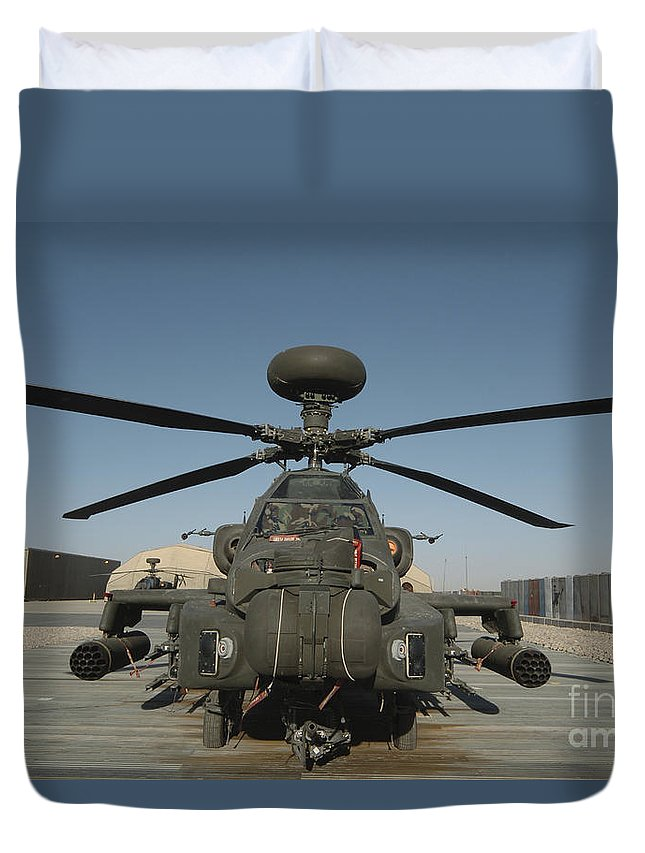 Ah-64 Apache Duvet Cover featuring the photograph An Apache Helicopter At Camp Bastion by Andrew Chittock