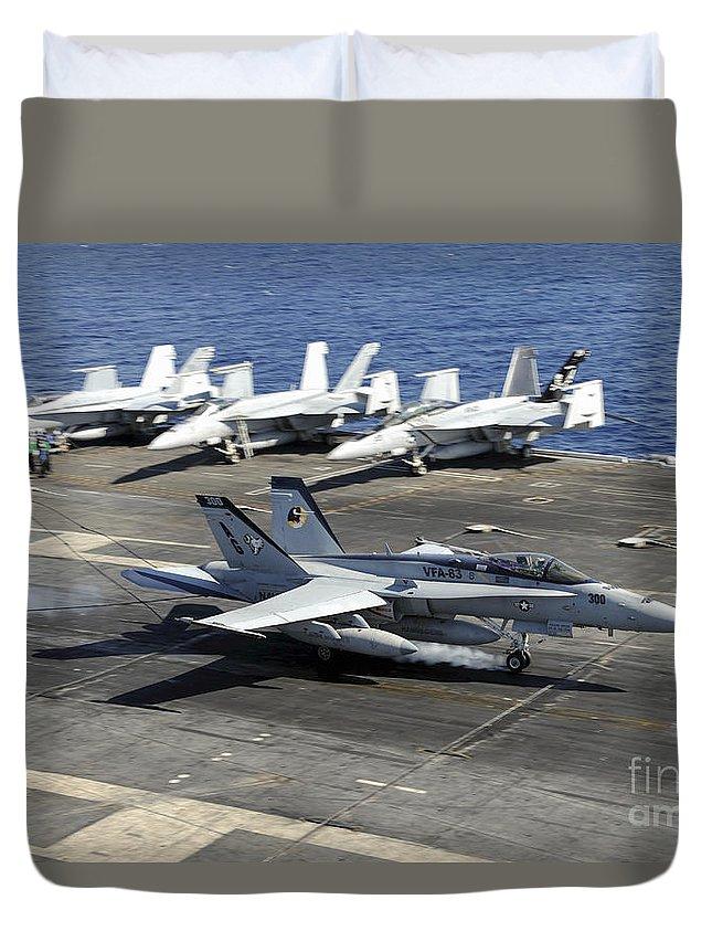 Uss Dwight D Eisenhower Duvet Cover featuring the photograph An Fa-18e Super Hornet Lands Aboard by Stocktrek Images