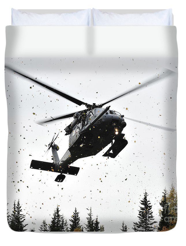 Infantry Duvet Cover featuring the photograph An Hh-60g Pave Hawk Helicopter Prepares by Stocktrek Images