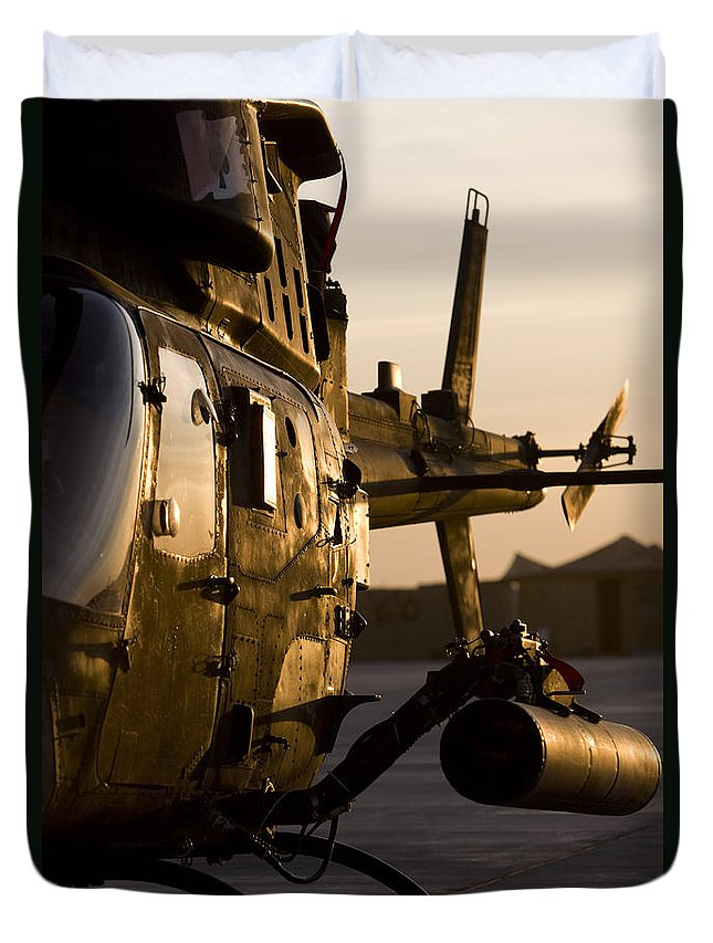 Aviation Duvet Cover featuring the photograph An Oh-58d Kiowa During Sunset by Terry Moore