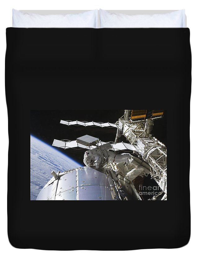Sts-128 Duvet Cover featuring the photograph Astronaut Working On The International by Stocktrek Images