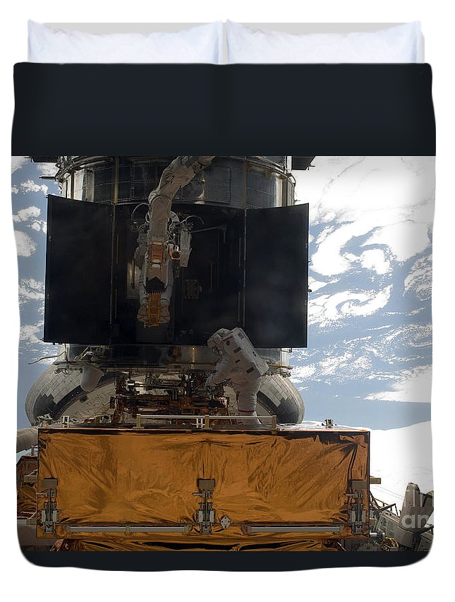 Outer Space Duvet Cover featuring the photograph Astronauts Working On The Hubble Space by Stocktrek Images