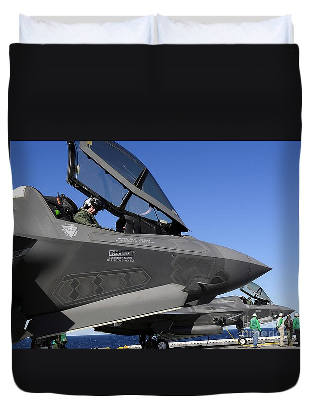 Aerospace Duvet Cover featuring the photograph F-35b Lightning II Variants Are Secured by Stocktrek Images