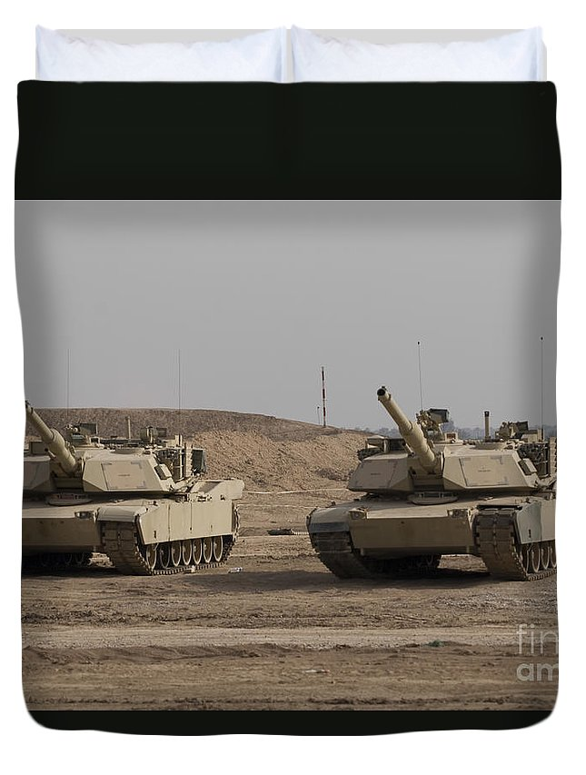 Camp Warhorse Duvet Cover featuring the photograph M1 Abrams Tank At Camp Warhorse by Terry Moore