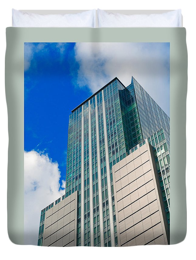 Abstract Duvet Cover featuring the photograph Skyscraper Front View With Blue Sky by U Schade
