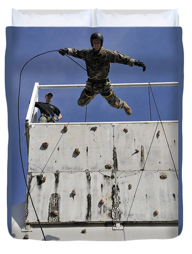 Rappelling Duvet Cover featuring the photograph Soldier Rappels Off A Tower While by Stocktrek Images
