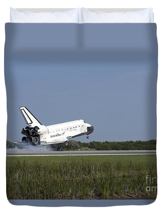 Sts-131 Duvet Cover featuring the photograph Space Shuttle Discovery Lands On Runway by Stocktrek Images
