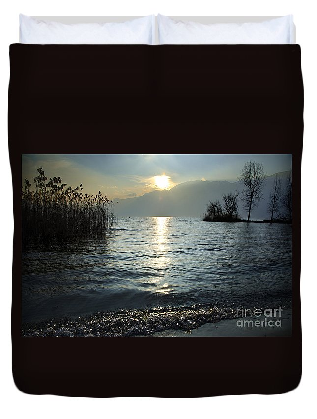 Sunset Duvet Cover featuring the photograph Sunset Over An Alpine Lake by Mats Silvan