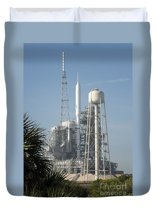 Ares Duvet Cover featuring the photograph The Ares I-x Rocket Is Seen by Stocktrek Images