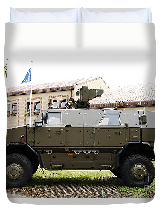 Armament Duvet Cover featuring the photograph The Multi-purpose Protected Vehicle by Luc De Jaeger