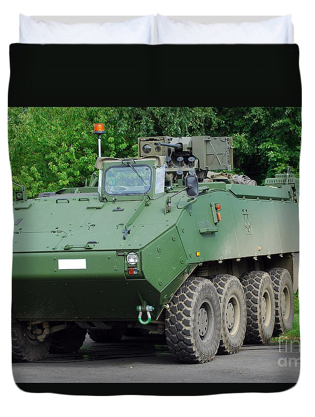 Armament Duvet Cover featuring the photograph The Piranha IIic Of The Belgian Army by Luc De Jaeger