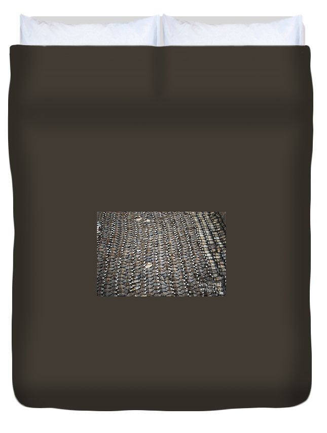 Horizontal Duvet Cover featuring the photograph Unexploded Ordnance Lies In Storage by Stocktrek Images