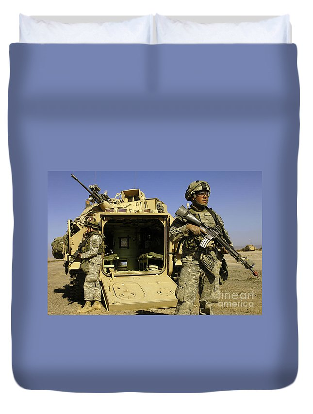 National Training Center Duvet Cover featuring the photograph U.s. Army Soldiers Provide Security by Stocktrek Images