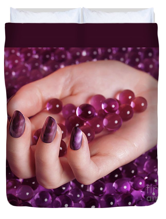 Nail Polish Duvet Cover featuring the photograph Woman Hand With Purple Nail Polish On Candy by Oleksiy Maksymenko