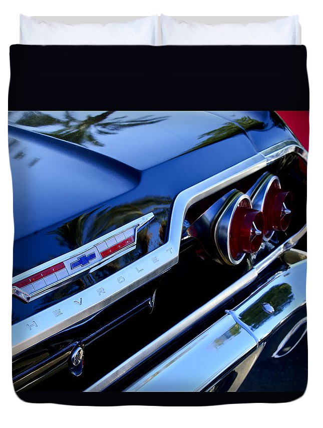 1963 Chevrolet Duvet Cover featuring the photograph 1963 Chevrolet Taillight Emblem by Jill Reger