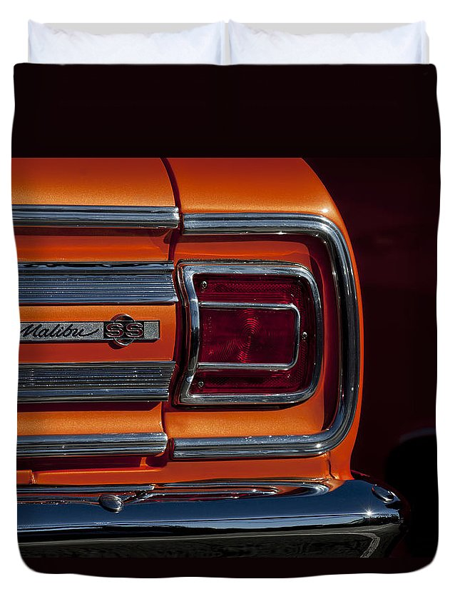 1965 Chevrolet Malibu Ss Duvet Cover featuring the photograph 1965 Chevrolet Malibu Ss Taillight Emblem by Jill Reger