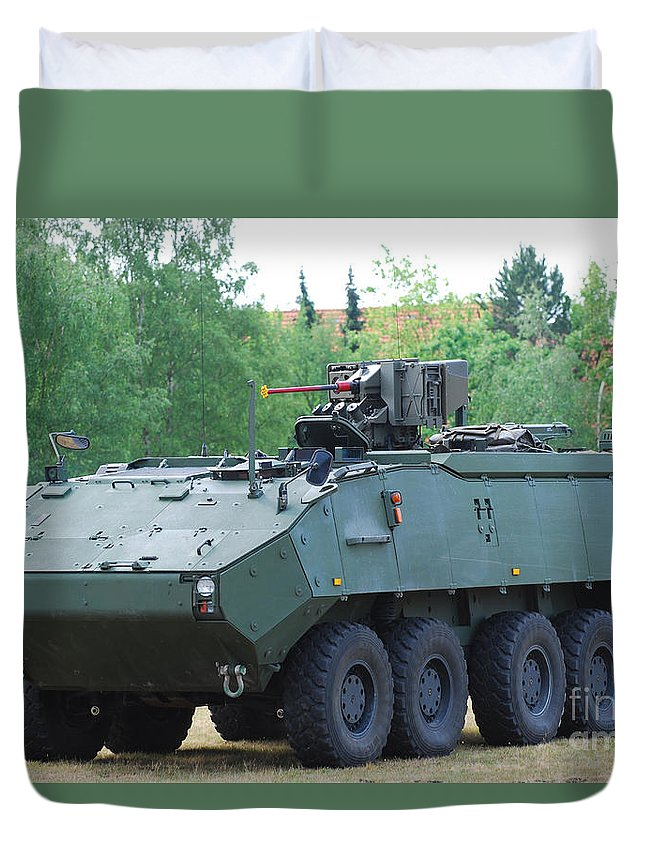 Land Component Duvet Cover featuring the photograph A Belgian Army Piranha IIic With The Fn by Luc De Jaeger