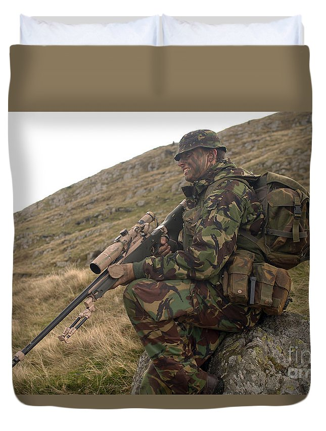 Foreign Military Duvet Cover featuring the photograph A British Soldier Armed With A Sniper by Andrew Chittock