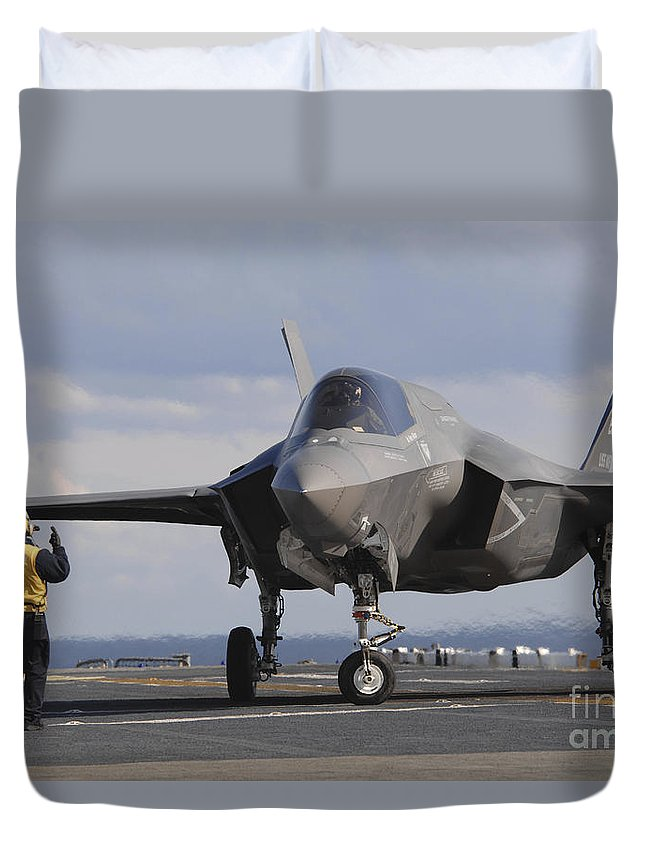 Landing Gear Duvet Cover featuring the photograph An Aviation Boatswains Mate Directs An by Stocktrek Images