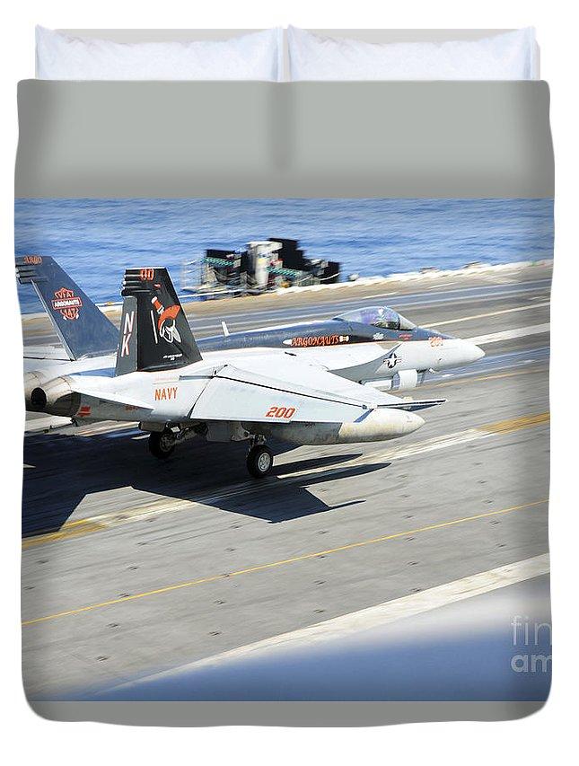 Aviation Duvet Cover featuring the photograph An Fa-18e Super Hornet Lands Aboard by Stocktrek Images