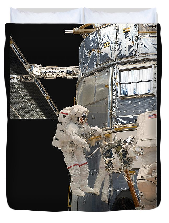 Sts-125 Duvet Cover featuring the photograph Astronauts Working On The Hubble Space by Stocktrek Images
