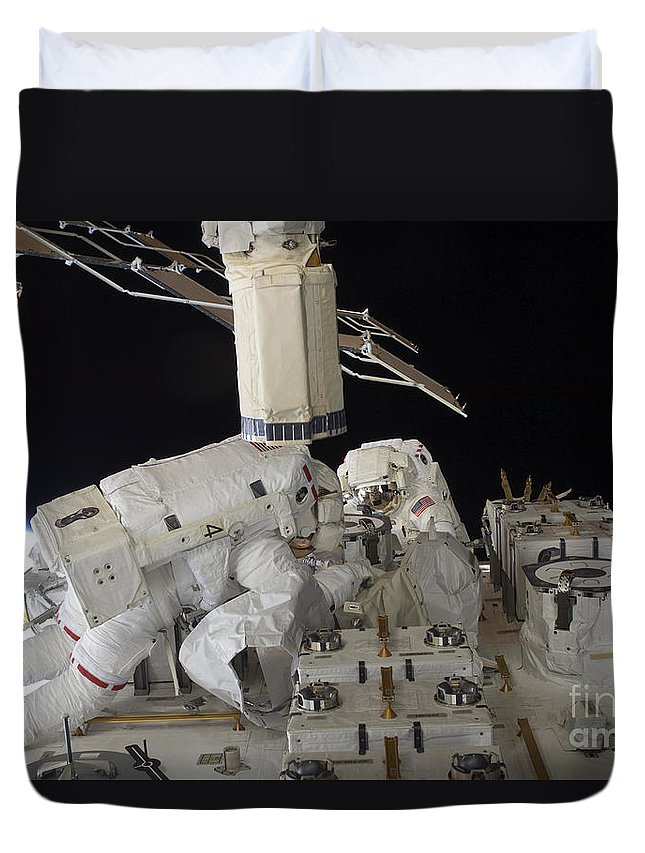 Sts-127 Duvet Cover featuring the photograph Astronauts Working On The International by Stocktrek Images