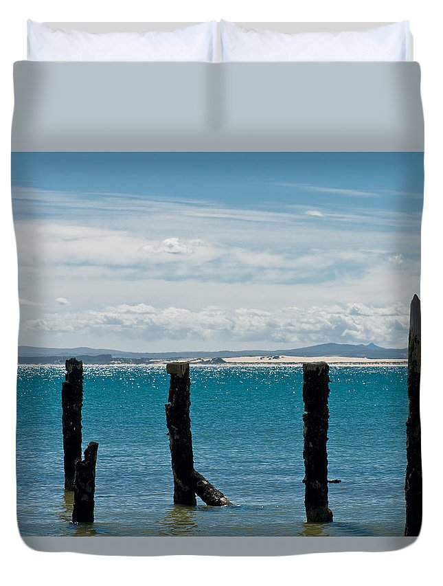 Abstract Duvet Cover featuring the photograph Beautiful Rotten Mooring On A Beach by U Schade