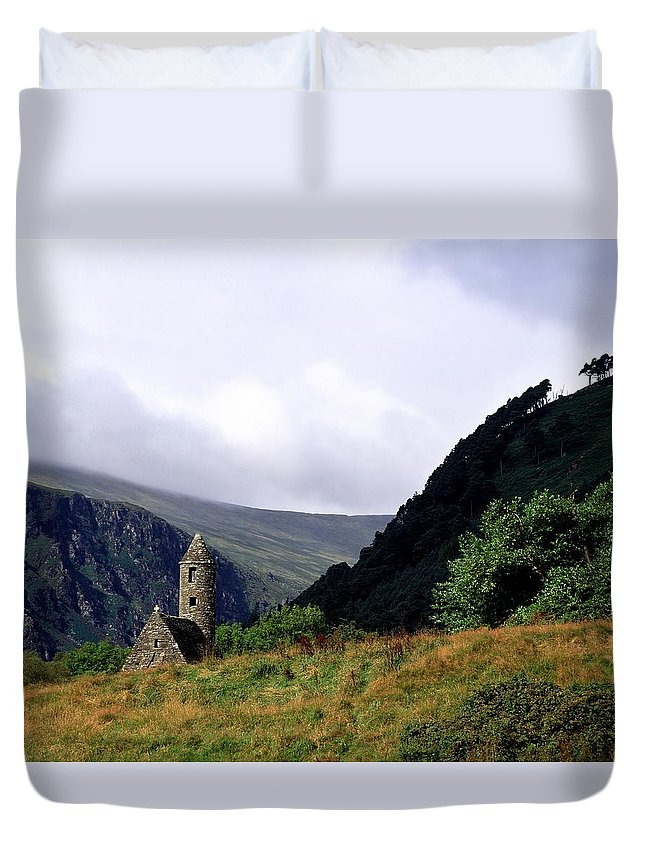 Copy Space Duvet Cover featuring the photograph Chapel Of Saint Kevin At Glendalough by The Irish Image Collection