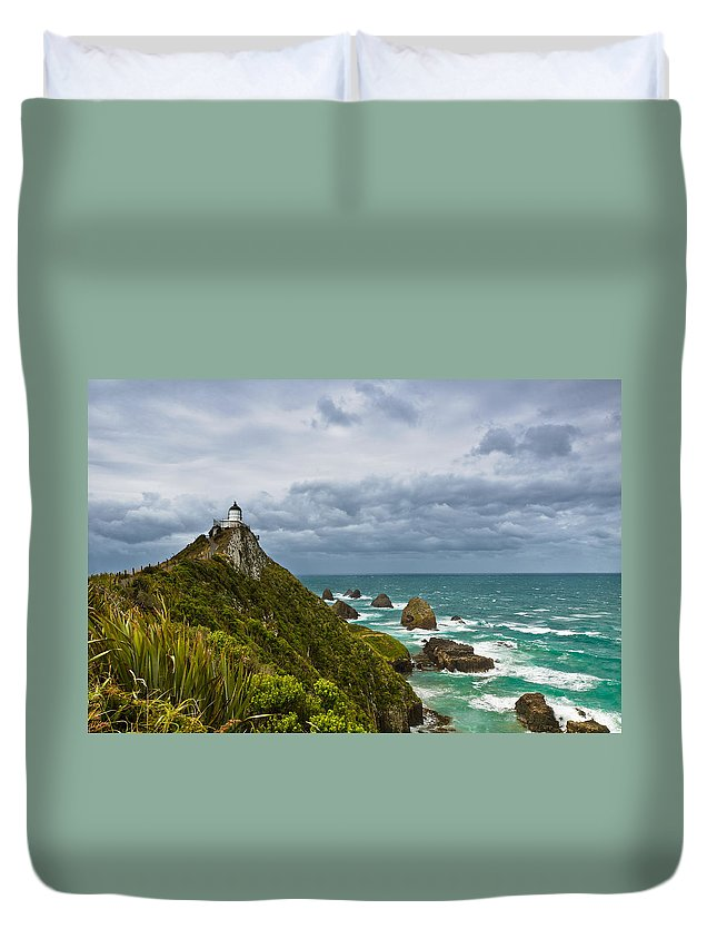 Beach Duvet Cover featuring the photograph Nugget Point Light House And Dark Clouds In The Sky by U Schade