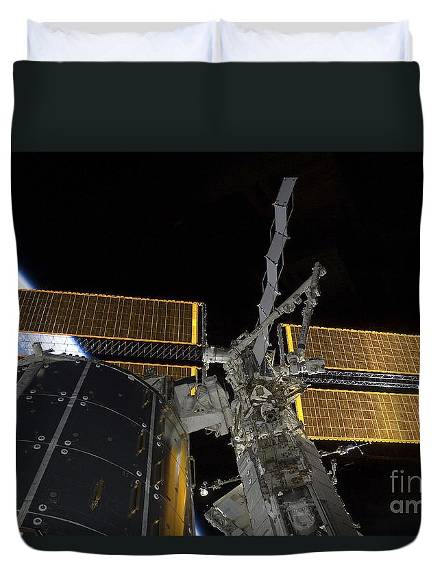 Technology Duvet Cover featuring the photograph The International Space Station by Stocktrek Images