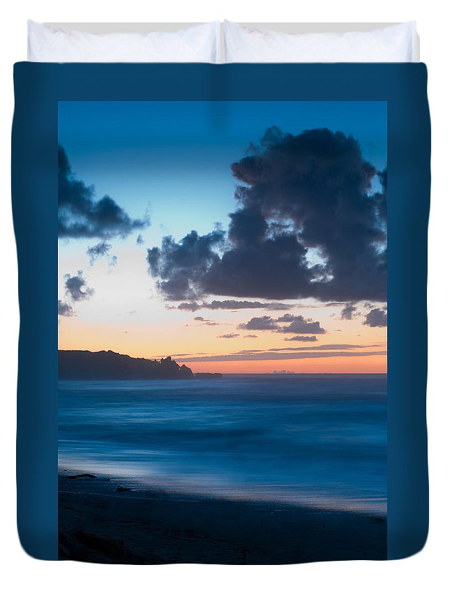 Beach Duvet Cover featuring the photograph A Beach During Sunset With Glowing Sky by U Schade