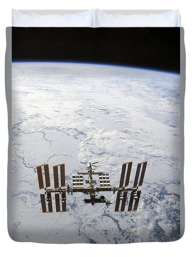 View From Space Duvet Cover featuring the photograph The International Space Station by Stocktrek Images
