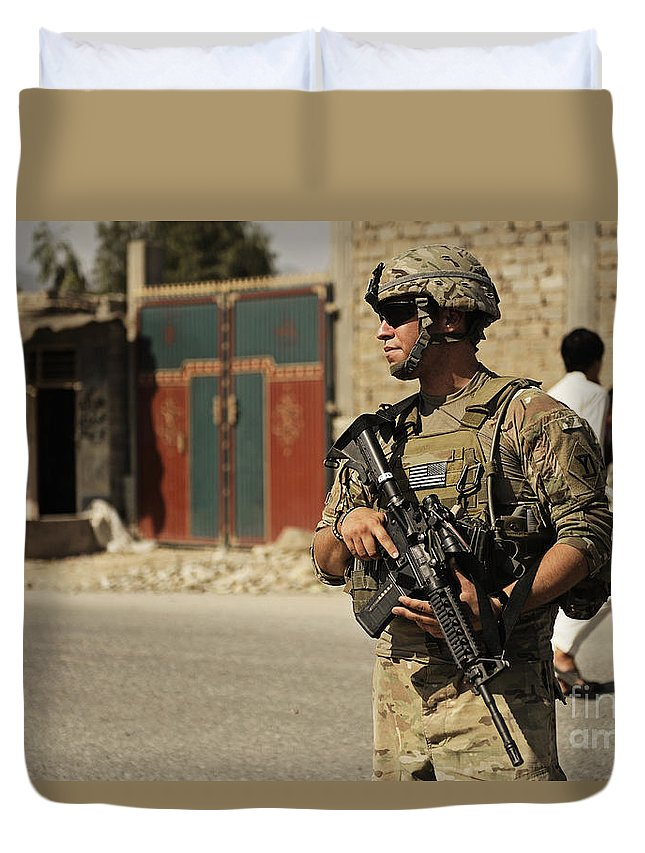 Security Forces Duvet Cover featuring the photograph U.s. Army Specialist Provides Security by Stocktrek Images