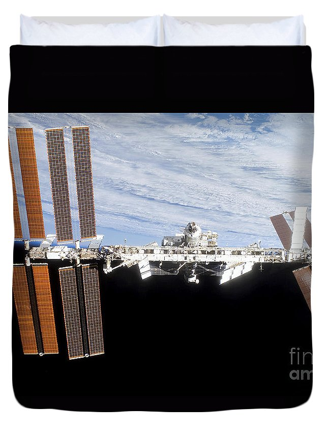 Blue Duvet Cover featuring the photograph International Space Station by Stocktrek Images