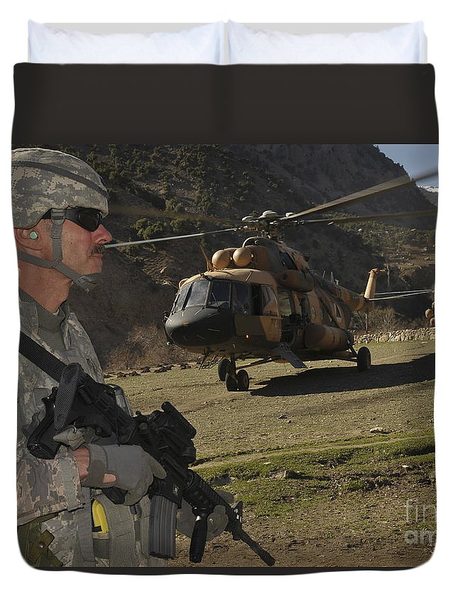 Security Duvet Cover featuring the photograph A Soldier Provides Security by Stocktrek Images