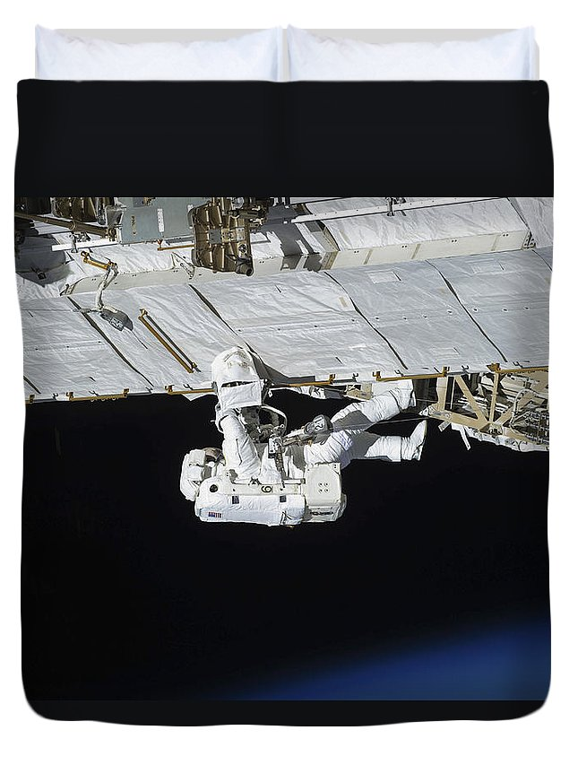 View From Space Duvet Cover featuring the photograph Astronaut Participates by Stocktrek Images