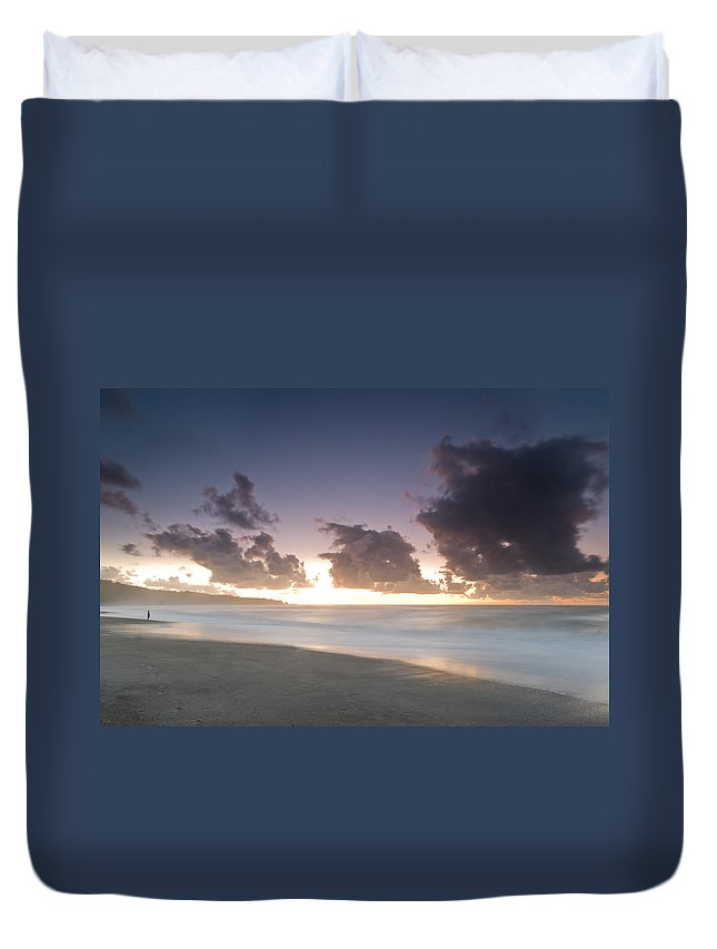 Beach Duvet Cover featuring the photograph A Beach During Misty Sunset With Glowing Sky by U Schade