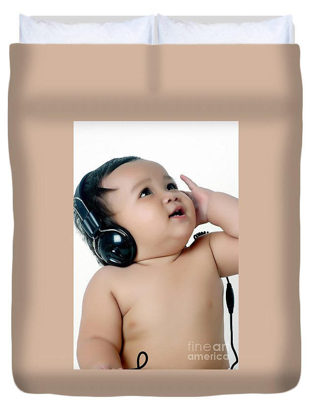 Baby Duvet Cover featuring the photograph A Chubby Little Girl Listen To Music With Headphones by Antoni Halim