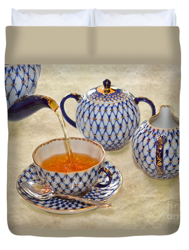Tea Duvet Cover featuring the photograph A Cup Of Tea Tea Being Poured Into A China Cup by Louise Heusinkveld
