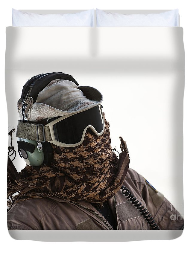 Clothing Duvet Cover featuring the photograph A Loadmaster Protects His Head by Stocktrek Images