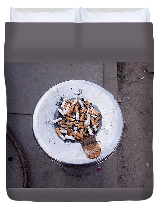 Stubs Duvet Cover featuring the photograph A Lot Of Cigarettes Stubbed Out At A Garbage Bin by Ashish Agarwal