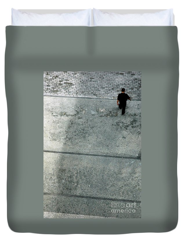 Walking Duvet Cover featuring the photograph A Man Walked Visible From Above by Antoni Halim