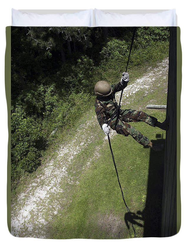 Training Exercise Duvet Cover featuring the photograph A Midshipman Rappels Down A Wall by Stocktrek Images