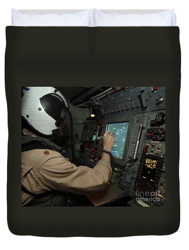 Operation Enduring Freedom Duvet Cover featuring the photograph A Naval Flight Officer Tracks Aircraft by Stocktrek Images