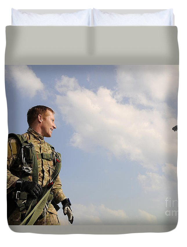 Instructor Duvet Cover featuring the photograph A Paratrooper Looks On As Other by Stocktrek Images